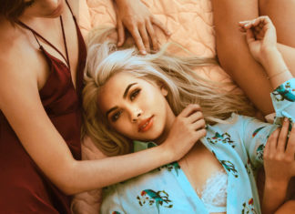 Hayley Kiyoko in bed One Bad Night tour