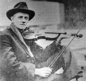 The racist, but musically significant, fiddler, Fiddlin' John Carson.