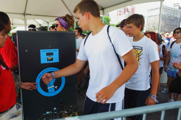 music festival tech rfid wristbands in use at lollapalooza